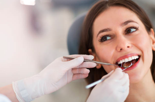 Dentist conducting dental checkup on patient