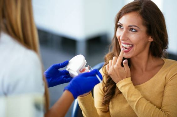 Dental assistant checking for cavitites